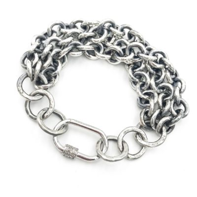 multi-strand heavy sterling silver bracelet with an oval diamond and sterling slver lock