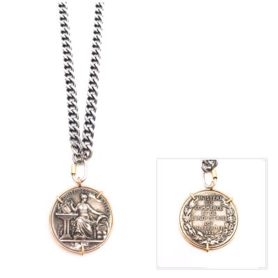 beautiful antique French medal set in 14kt gold hanging from an oxidized sterling silver chain