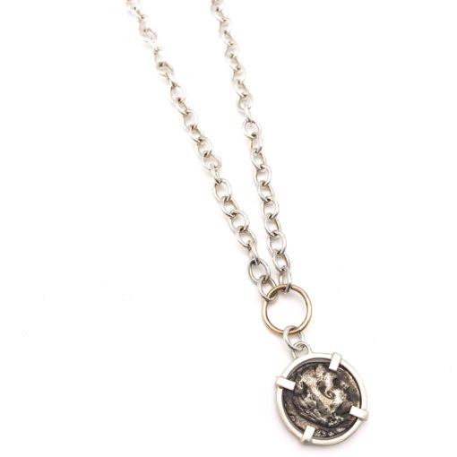 Ancient Roman coin set in sterling silver, hanging on a 14kt gold loop from a sterling silver chain