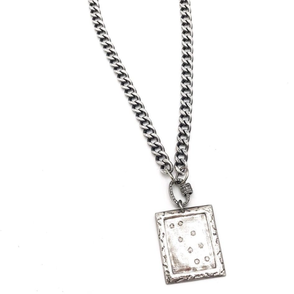 heavy oxidized sterling silver chain with a large diamond dog tag hanging on a diamond lock